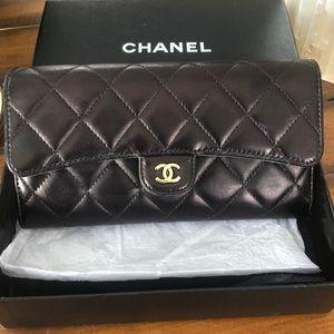 Authentic Chanel matrasse flap wallet gold CC.